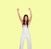 Attractive girl dressed in white on yellow Royalty Free Stock Images