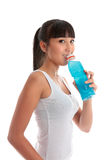 Attractive girl drinking  after exercise Royalty Free Stock Photography
