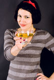 Attractive girl drinking vine Stock Image