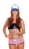 Attractive girl drinking water after training Royalty Free Stock Photos