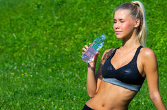 Attractive girl drinking water Royalty Free Stock Image