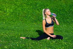 Attractive girl drinking water Stock Images