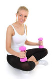 Attractive girl with dumbbells Royalty Free Stock Image