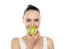 Attractive girl eating fresh juicy green apple Royalty Free Stock Image
