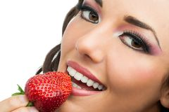 Attractive girl eating strawberry. Royalty Free Stock Photo