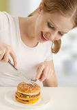 Attractive girl  eats hamburger Stock Photo