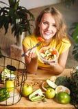 Attractive Girl Eats Salad Royalty Free Stock Image