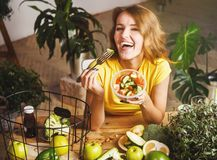 Attractive Girl Eats Salad Royalty Free Stock Photos