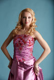 Attractive girl in elegant pink dress Royalty Free Stock Photography