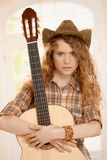Attractive girl embracing guitar Stock Image