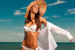 Attractive girl enjoys hot summer day at the beach. Royalty Free Stock Image