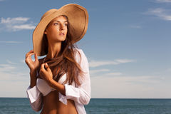 Attractive girl enjoys hot summer day at the beach. Royalty Free Stock Images