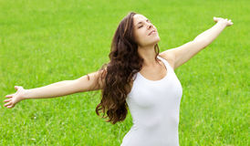 Attractive girl enjoys nature Royalty Free Stock Photo