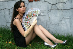 Attractive girl with a fan Royalty Free Stock Image
