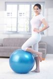 Attractive girl with fitness ball smiling Stock Photo