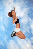 Attractive girl with fitness clothing jumping Stock Images