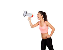 Attractive girl with fitness clothing and megaphone. Isolated on a white background Stock Photos