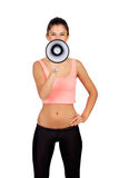 Attractive girl with fitness clothing and megaphone. Isolated on a white background Royalty Free Stock Photos