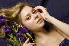 Attractive girl with flowers iris Royalty Free Stock Photos