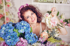 Attractive girl with flowers. Young attractive brunette girl with flowers Royalty Free Stock Images