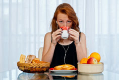 Attractive girl with freckles drinking from cup Royalty Free Stock Images