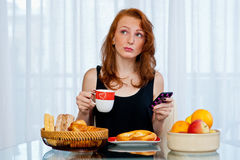 Attractive girl with freckles eating breakfast Stock Photo
