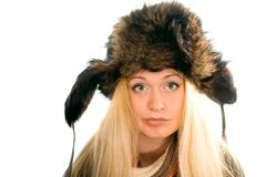 Attractive girl in fur cap Royalty Free Stock Photo