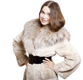 Attractive girl in a fur coat Stock Photos