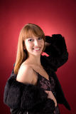 Attractive girl in fur coat Stock Images