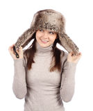 Attractive girl in a fur hat isolated on white. Over white background royalty free stock photography