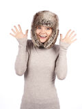 Attractive girl in a fur hat isolated on white Royalty Free Stock Photos