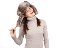 Attractive girl in a fur hat isolated on white Royalty Free Stock Photo