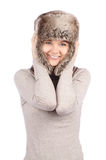 Attractive girl in a fur hat isolated on white Royalty Free Stock Images