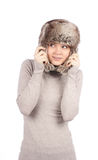 Attractive girl in a fur hat isolated on white Stock Image