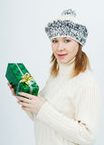 Attractive girl with a gift in their hands Royalty Free Stock Image