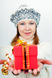 Attractive girl gives a wrapped gift Stock Photo
