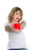 Attractive girl giving red cup Royalty Free Stock Photo