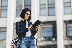 attractive girl in glasses with tablet outside stock photography
