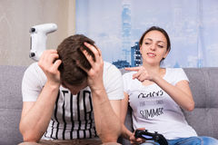 Attractive girl gloating after winning a video game Stock Image