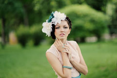 Attractive girl in the green garden Royalty Free Stock Photography