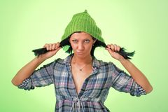 Attractive girl in green woollen cap Royalty Free Stock Photos