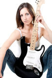 Attractive girl with guitar. Isolated on white Stock Photography