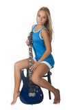 Attractive girl with guitar. Young beautiful woman with electric guitar. Isolated on white Stock Photo