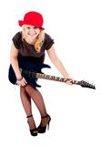 Attractive girl with guitar. Young beautiful woman with electric guitar. Isolated on white Royalty Free Stock Photos