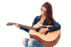 Attractive girl with guitar in hands. Portrait of attractive girl with guitar in hands with closed eyes isolated on white background Royalty Free Stock Images