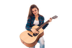 Attractive girl with guitar in hands. Smiling isolated on white background Stock Photo