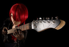 Attractive girl with guitar, high angle view. Attractive girl with guitar, selective focus on fingers, high angle view Stock Photos