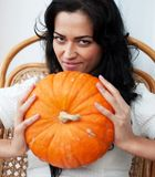 Attractive girl hair holding pumpkins and smiling Royalty Free Stock Image