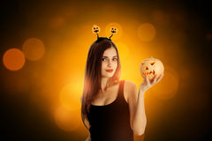 Attractive girl in halloween style clothes Stock Image