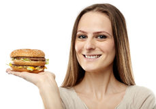 Attractive girl with hamburger Stock Images